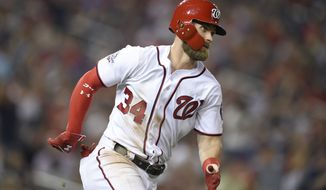 Washington Nationals' Bryce Harper runs toward first with a single during the fourth inning of the team's baseball game against the Philadelphia Phillies, Wednesday, Aug. 22, 2018, in Washington. (AP Photo/Nick Wass)