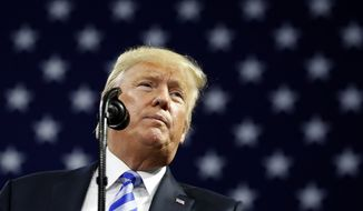 President Donald Trump pauses while speaking during a rally Tuesday, Aug. 21, 2018, in Charleston, W.Va. (AP Photo/Alex Brandon)
