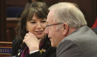 FILE - In this Jan. 17, 2017 file photo House Minority Leader Charisse Millett, R-Anchorage, left, confers with state Rep. Mike Chenault, R-Nikiski, during the opening session of the Alaska Legislature. Unofficial results showed three Republican Alaska state legislators, Senate Majority Leader Micciche, House Minority Leader Millett and House Rules Chair Gabrielle LeDoux, all of whom hold leadership positions trailing in their primary elections. Those results could change when questioned and absentee ballots are counted. The Division of Elections on Wednesday, Aug. 22, 2018, said it was processing ballots and did not yet have a number of questioned or absentee ballots. (AP Photo/Mark Thiessen, File)