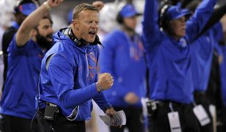 FILE - In this Oct. 28, 2017, file photo, Boise State head coach Bryan Harsin celebrates after the Broncos made a third down stop against Utah State during an NCAA football game, in Logan, Utah. When Harsin returned to Boise State, he initially took over a program of Chris Petersen's players and immediately won a New Year's bowl game. Now all those players have cycled through, but the 22nd-ranked Broncos still have the same lofty expectations. (Eli Lucero/Herald Journal via AP, File)