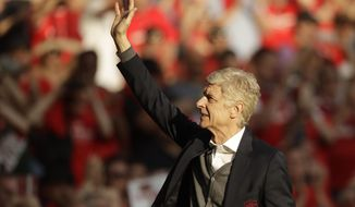 FILE - In a Sunday, May 6, 2018 file photo, Arsenal's French manager Arsene Wenger waves to spectators during his lap of honor at the Emirates Stadium in London. Liberian President and former soccer star George Weah is being criticized for his plan to award Arsene Wenger the West African country's highest honor. Weah, who was elected president of his country last year, plans to honor Wenger and another French soccer coach, Claude Le Roy. They both played crucial roles in Weah's career. (AP Photo/Matt Dunham, File)