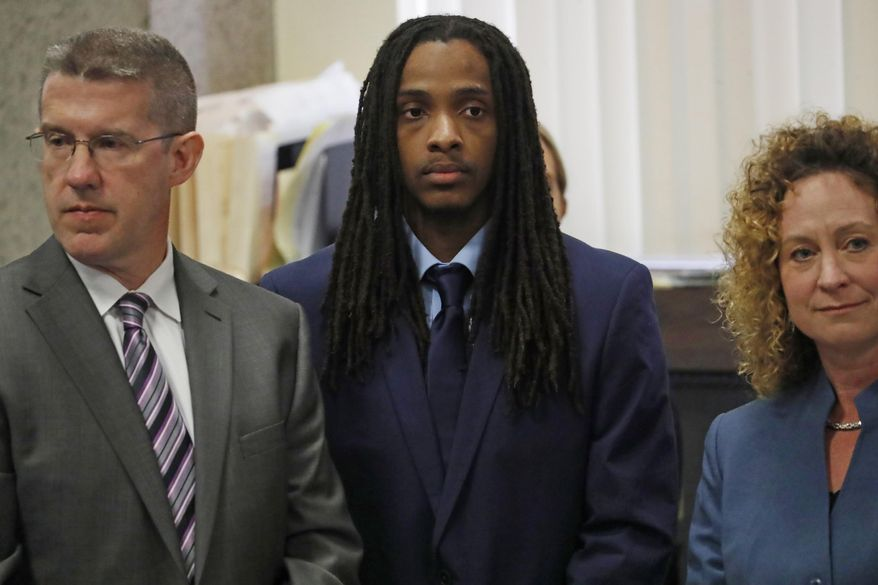 FILE - In this Aug. 14, 2018 file photo, defendant Kenneth Williams, center, is flanked by attorneys Matt McQuaid, and Julie Koehler, during opening arguments in the Hadiya Pendleton murder trial at the Leighton Criminal Court Building in Chicago. Williams, and Micheail Ward are standing trial in the 2013 shooting death of Pendleton, a 15-year-old Chicago honor student. Jurors in the trial of Williams began deliberations Wednesday, Aug. 22, 2018, following closing arguments from attorneys. (Jose M. Osorio/Chicago Tribune via AP, Pool File)
