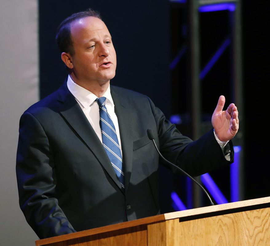 In this June 18, 2018 file photo Colorado Democratic gubernatorial candidate Jared Polis responds to a question during a televised debate in Denver, Colo. Polis outlined his energy policy Wednesday, Aug. 22, 2018, at a meeting of the Colorado Oil and Gas Association in Denver. Polis said the oil and gas industry is vital to Colorado's economy but the state has to address persistent conflicts between the industry and neighborhoods. (AP Photo/David Zalubowski,File)