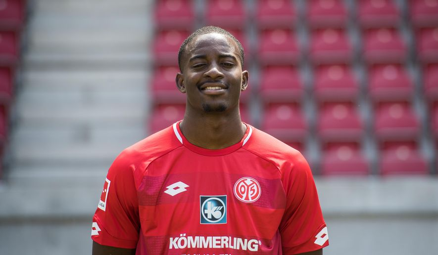 FILE - In this Tuesday, July 24, 2018 photo Mainz' Jean-Philippe Mateta poses during the new season's official photo call of the German first division, Bundesliga, soccer team 1. FSV Mainz 05 in Mainz, Germany. (Andreas Arnold/dpa via AP)