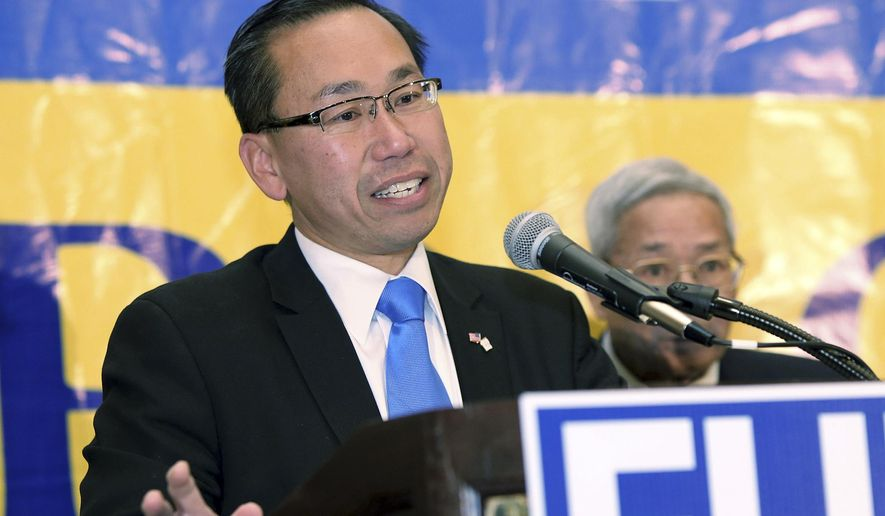 FILE - In this Nov. 4, 2014, file photo, Republican candidate for Governor Allan Fung concedes defeat to Democrat Gina Raimondo in Warwick, R.I. Fung is seeking his party's nomination to again run for governor in the Sept. 12, 2018 primary. Fung promoted his candidacy on an hour-long radio infomercial hosted by a trucking industry lobbyist, and campaign records reviewed by The Associated Press show he failed to report the donation of radio air time. (AP Photo/Joe Giblin, File)