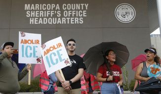 Immigration activists protest against the Maricopa County Sheriff and Immigration and Customs Enforcement at the county jail in an ongoing effort to get immigration authorities out of the jail Wednesday, Aug. 22, 2018, in Phoenix. (AP Photo/Ross D. Franklin)