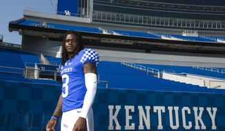FILE - In this Aug. 3, 2018, file photo, sophomore Terry Wilson (3) poses at Kentucky NCAA college football media day at Kroger field in Lexington, Ky. Kentucky coach Mark Stoops will choose transfer Terry Wilson or redshirt sophomore Gunnar Hoak as the Wildcats' starting quarterback against Central Michigan but stressed that both will play. The competition is so close that the position might be a group effort early in the season. (Silas Walker/Lexington Herald-Leader via AP, File)