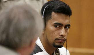 Cristhian Bahena Rivera speaks with his attorney during his initial court appearance, Wednesday, Aug. 22, 2018, at the Poweshiek County Courthouse in Montezuma, Iowa. Rivera is charged with first-degree murder in the death of Mollie Tibbetts, who disappeared July 18 from Brooklyn, Iowa. (Jim Slosiarek/The Gazette via AP, Pool)