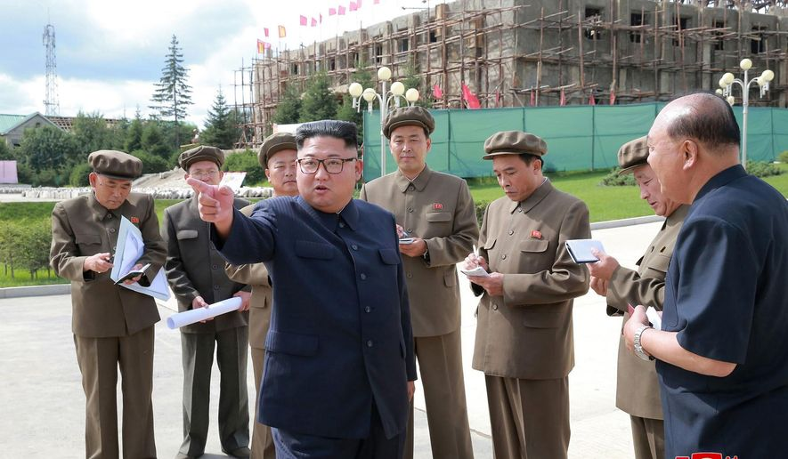 """In this undated photo, provided on Aug. 19, 2018, by the North Korean government, North Korean leader Kim Jong Un, center, visits a construction site during a visit to the city of Samjiyon, a remote northern city near the Chinese border.  North Korea is speeding up the pace of a massive nationwide construction campaign ahead of its 70th anniversary in what leader Kim has described as a symbolic battle against anyone who would oppose his country. Independent journalists were not given access to cover the event depicted in this image distributed by the North Korean government. The content of this image is as provided and cannot be independently verified. Korean language watermark on image as provided by source reads: """"KCNA"""" which is the abbreviation for Korean Central News Agency. (Korean Central News Agency/Korea News Service via AP)"""