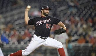 Washington Nationals starting pitcher Tanner Roark delivers a pitch during the third inning of a baseball game against the Philadelphia Phillies, Tuesday, Aug. 21, 2018, in Washington. (AP Photo/Nick Wass) ** FILE **