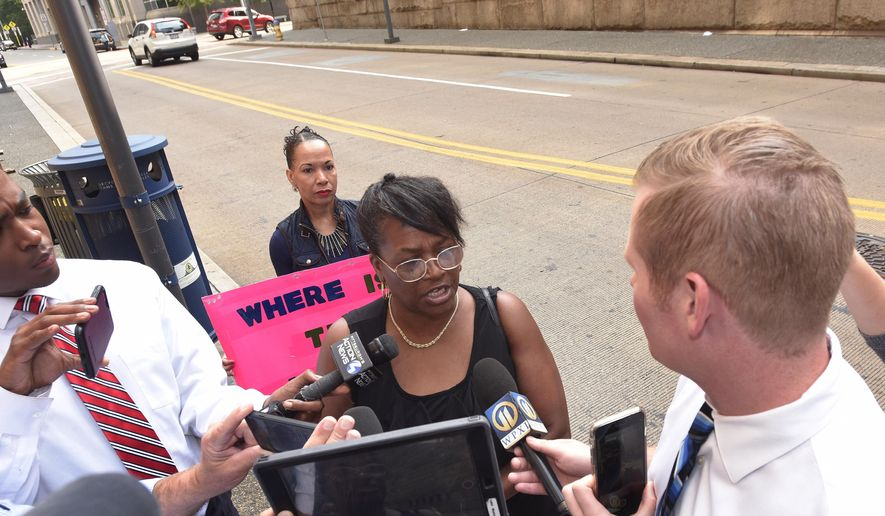 Carmen Ashley, great aunt of Antwon Rose Jr. talks with reporters outside of the courthouse following a hearing for East Pittsburgh police officer Michael Rosfeld on Wednesday, Aug. 22, 2018, in Pittsburgh. Rosfeld is charged in the June 19 shooting death of Rose, an unarmed teenager, as he fled a traffic stop. (AP Photo/Don Wright)