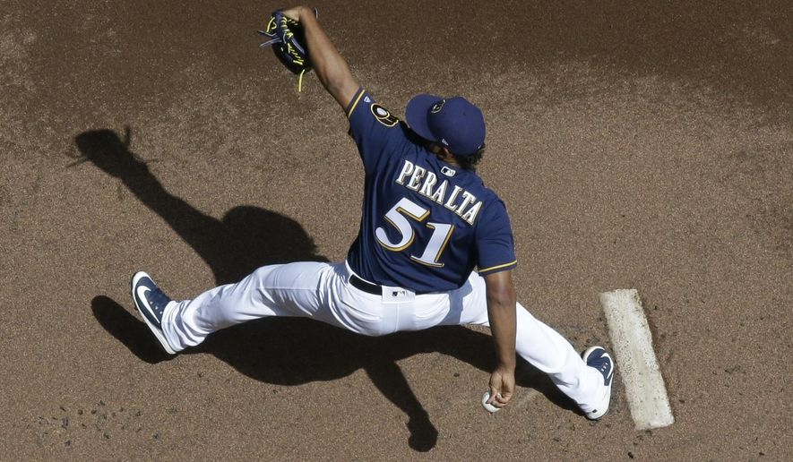 Milwaukee Brewers starting pitcher Freddy Peralta throws during the first inning of a baseball game against the Cincinnati Reds Wednesday, Aug. 22, 2018, in Milwaukee. (AP Photo/Morry Gash)
