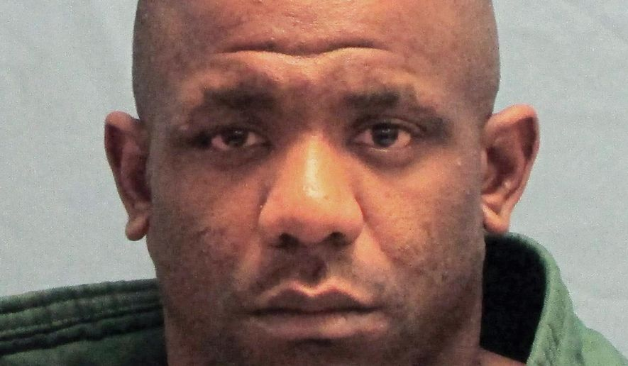 FILE - This undated file photo released by the Pulaski County Sheriff's Office in Little Rock, Ark., shows Gary Eugene Holmes, who was convicted by a jury Wednesday, Aug. 22, 2018, of first-degree murder and terrorist threatening in the December 2016 death of Acen King. He was accused of firing his gun into another driver's car and killing the 3-year-old boy. (Pulaski County Sheriff's Office via AP, File)