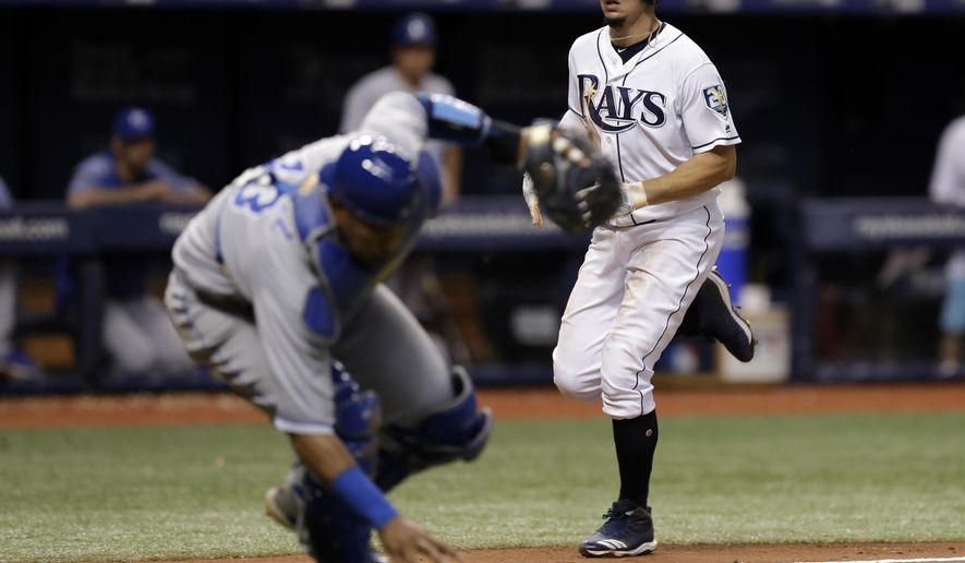 Tampa Bay Rays' Willy Adames, right, scores as Kansas City Royals catcher Salvador Perez picks up a squeeze bunt by Carlos Gomez during the sixth inning of a baseball game Wednesday, Aug. 22, 2018, in St. Petersburg, Fla. (AP Photo/Chris O'Meara)