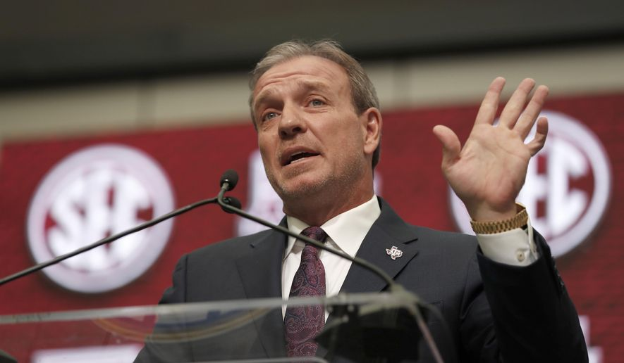 FILE - In this July 16, 2018, file photo, Texas A&M head coach Jimbo Fisher speaks at Southeastern Conference Media Days in Atlanta. Texas A&M handed Fisher a 10-year, $75 million contract to leave Florida State after Kevin Sumlin was fired last year. Aggie fans believe that's 75 million reasons why he should be the one to deliver their first national title since 1939. He knew what the expectations were before the ink was dry on the deal. And he insists he isn't daunted by them.(AP Photo/John Bazemore)