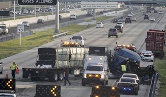 FILE- In this May 1, 2018, file photo authorities investigate after truck jackknifed in the northbound lanes of Interstate 75 in Davie, Fla. The National Safety Council on Wednesday, Aug. 22, estimated that 18,720 people were killed in traffic crashes from January through June, down about one-half percent from a year ago. (Joe Cavaretta/South Florida Sun-Sentinel via AP, File)