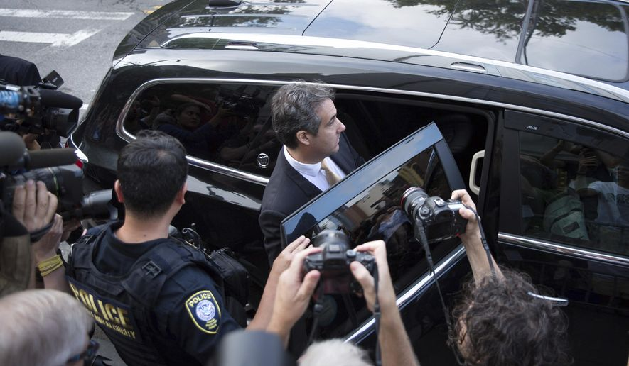 Michael Cohen, former lawyer to President Donald Trump, departs following his appearance in Federal Court on Tuesday, Aug. 21, 2018, in New York. Cohen, has pleaded guilty to charges including campaign finance fraud stemming from hush money payments to porn actress Stormy Daniels and ex-Playboy model Karen McDougal. (AP Photo/Kevin Hagen)