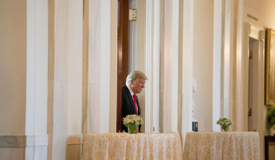 President Donald Trump arrives to award the Medal of Honor posthumously to Air Force Tech. Sgt. John A. Chapman, for conspicuous gallantry during a ceremony in the East Room of the White House in Washington, Wednesday, Aug. 22, 2018. (AP Photo/Andrew Harnik)