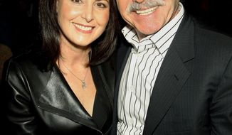 In this Jan. 31, 2014 photo, David Pecker, Chairman and CEO of American Media, poses with his wife, Karen Pecker, at the Shape & Men's Fitness Super Bowl Party in New York. The Aug. 21, 2018 plea deal reached by Donald Trump's former attorney Michael Cohen has laid bare a relationship between the president and Pecker, whose company publishes the National Enquirer. Besides detailing tabloid's involvement in payoffs to porn star Stormy Daniels and Playboy Playmate Karen McDougal to keep quiet about alleged affairs with Trump, court papers showed how David Pecker, a longtime friend of the president, offered to help Trump stave off negative stories during the 2016 campaign. (AP Photo/Marion Curtis)