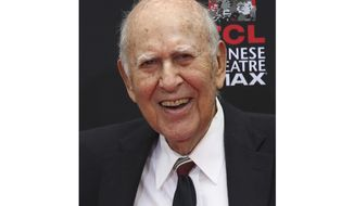 """FILE - In this Sept. 8, 2014 file photo, Carl Reiner appears at the TCL Chinese Theatre in Hollywood section of Los Angeles. The 96-year-old creator of """"The Dick Van Dyke Show"""" already has 12 Emmy trophies. He is nominated as narrator of the documentary """"If You're Not in the Obit, Eat Breakfast,"""" which looks at how people stay active and vibrant. The Emmy Awards will air Sept. 19 on NBC. (AP Photo/Nick Ut, File)"""