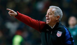 FILE - In this Nov. 14, 2017, file photo, U.S. interim coach Dave Sarachan gestures during an international friendly soccer match between Portugal and U.S. in Leiria, Portugal. Sarachan is not committing to when or how veterans like Michael Bradley and Jozy Altidore will be brought in again for the U.S. roster, the coach said Wednesday, Aug. 22, 2018. (AP Photo/Pedro Rocha, File)
