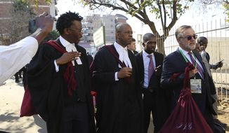 "Lawyers representing the opposition party in Zimbabwe are seen upon arrival at the Constitutional Court in Harare, Wednesday, Aug, 22, 2018, to begin a challenge to the results of last months historic presidential election. The opposition claims the vote had ""gross mathematical errors"" and seeks a fresh election or a declaration of its candidate Nelson Chamisa as the winner of the July 30 vote. (AP Photo/Tsvangirayi Mukwazhi)"