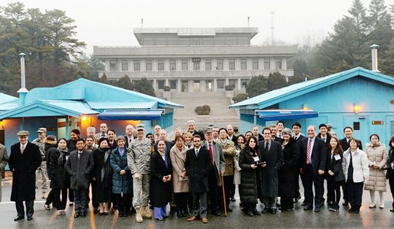 The Washington Times fact-finding delegation toured Pan Mun Jom, the village that straddles the DMZ. (PHOTO CREDIT: HSA-UWC)