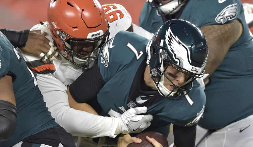 Cleveland Browns defensive tackle Caleb Brantley (99) sacks Philadelphia Eagles quarterback Nate Sudfeld (7) during the second half of an NFL preseason football game Thursday, Aug. 23, 2018, in Cleveland. (AP Photo/David Richard)