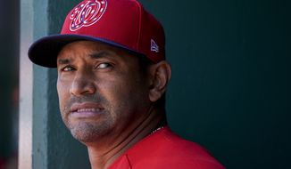 Washington Nationals manager Dave Martinez stands in the dugout before a baseball game against the Philadelphia Phillies at Nationals Park Thursday, Aug. 23, 2018, in Washington. The Phillies won 2-0. (AP Photo/Andrew Harnik)