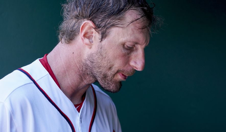 Washington Nationals starting pitcher Max Scherzer walks through the dugout during a baseball game against the Philadelphia Phillies at Nationals Park Thursday, Aug. 23, 2018, in Washington. The Phillies won 2-0. (AP Photo/Andrew Harnik)