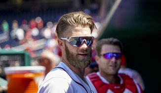 Washington Nationals' Bryce Harper stands in the dugout before a baseball game against the Philadelphia Phillies at Nationals Park Thursday, Aug. 23, 2018, in Washington. The Phillies won 2-0. (AP Photo/Andrew Harnik)