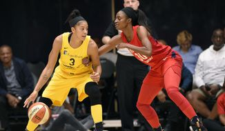 Los Angeles Sparks forward Candace Parker (3) dribbles against Washington Mystics forward LaToya Sanders (30) in the first half of a single elimination WNBA basketball playoff game, Thursday, Aug. 23, 2018, in Washington. (AP Photo/Nick Wass)