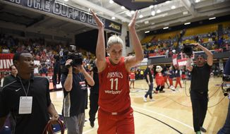Washington Mystics guard Elena Delle Donne celebrates after the team's single-elimination WNBA basketball playoff game against the Los Angeles Sparks, Thursday, Aug. 23, 2018, in Washington. The Mystics won 96-64. (AP Photo/Nick Wass) ** FILE **