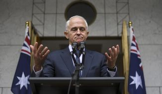 Australian Prime Minister Malcolm Turnbull speaks to the media during a press conference at Parliament House in Canberra, Thursday, Aug. 23, 2018. The beleaguered prime minister warned he will quit Parliament on Friday if his disgruntled party continues to try to oust him, forcing a by-election that could cost the government its single-seat majority or push his successor into immediately calling general elections. (Lukas Coch/AAP Image via AP)