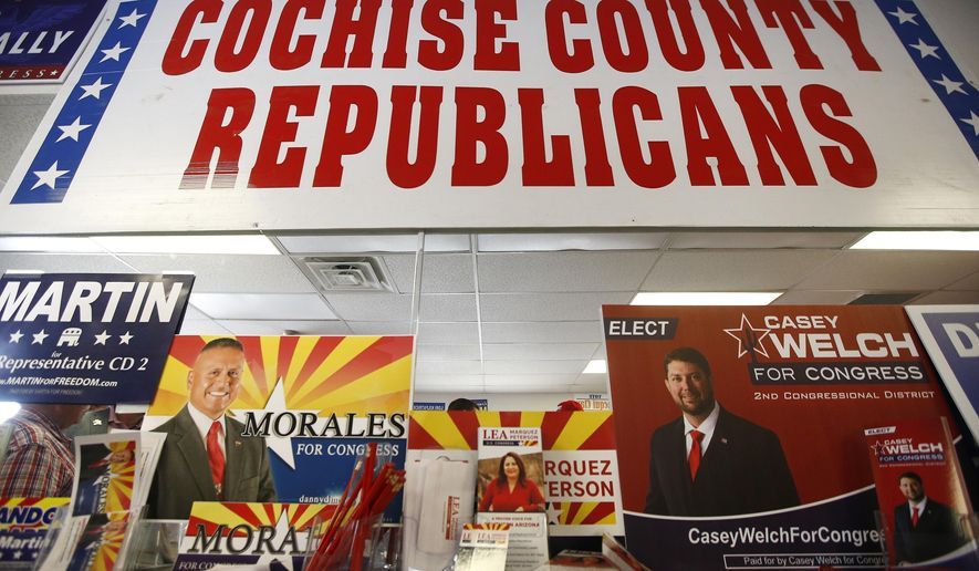 In this Aug. 6, 2018, photo, Campaign information for all the Republican candidates for the 2nd Congressional District are set up at a Republican party event in Sierra Vista, Ariz. Arizona's 2nd Congressional District is a primary battle as seven Democrats and four Republicans seek to succeed Republican Rep. Martha McSally, who is for a U.S. Senate seat. (AP Photo/Ross D. Franklin)