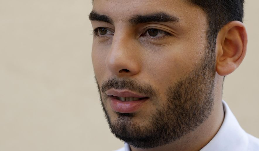 Democratic congressional candidate Ammar Campa-Najjar speaks during an interview Wednesday, Aug. 22, 2018, in San Diego. Despite an ongoing FBI investigation into his campaign spending, Campa-Najjar's competitor, U.S. Rep. Duncan Hunter, coasted through the June primary election largely unscathed. But on Tuesday, the Republican congressman and his wife were charged by a federal grand jury with using more than $250,000 in campaign funds for personal gain. The indictment brings a jolt of uncertainty into the contest, in a year when Democrats have targeted a string of Republican-held House seats across the state. (AP Photo/Gregory Bull)