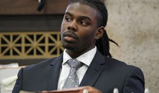 In this Wednesday, Aug. 22, 2018 photo, defendant Micheail Ward listens during the trial for the fatal shooting of Hadiya Pendleton at the Leighton Criminal Court Building in Chicago. A jury could soon get the case of Ward who prosecutors say fired shots in 2013 that killed the 15-year-old high school honor student who became a national symbol of Chicago gun violence. Closing arguments in Ward's case are Thursday, Aug. 23, 2018. (Jose M. Osorio/ Chicago Tribune via AP, Pool)