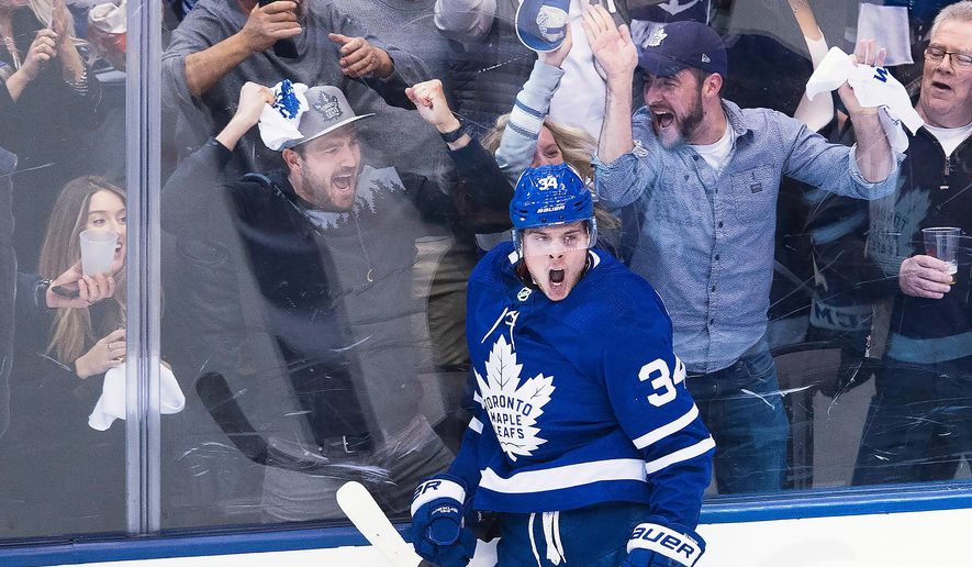 FILE - In this April 16, 2018, file photo, Toronto Maple Leafs center Auston Matthews (34) reacts after scoring against the Boston Bruins during second period NHL, round one playoff hockey game in Toronto. When the Arizona Coyotes moved to the desert in 1996, the youth hockey scene in the desert was nearly non-existent. With the help of the Coyotes and a big boost from Auston Matthews' popularity, Arizona has become one of the fastest-growing areas for grassroots hockey. (Nathan Denette/The Canadian Press via AP, File)