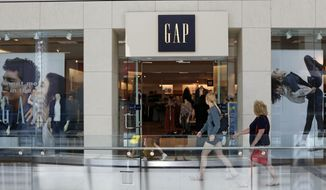 FILE- This Aug. 31, 2017, file photo shows a sign for a Gap store in Pittsburgh. The Gap Inc. reports earnings Thursday, Aug. 23. (AP Photo/Gene J. Puskar, File)