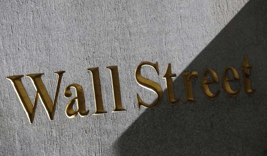 FILE - This March 4, 2013, file photo shows a sign for Wall Street on the side of a building near the New York Stock Exchange. The U.S. stock market opens at 9:30 a.m. EDT on Thursday, Aug. 23, 2018. (AP Photo/Mark Lennihan, File)