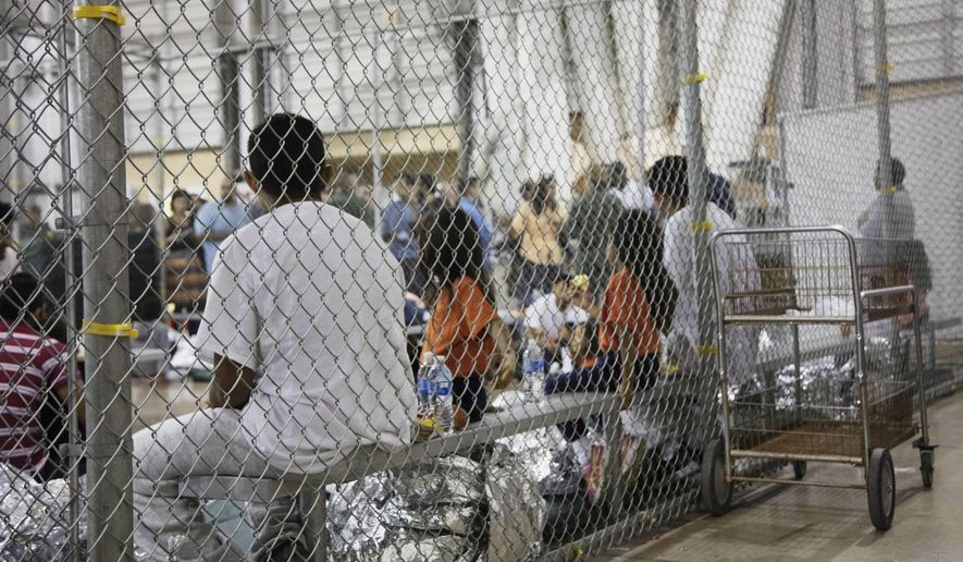 In this June 17, 2018, file photo provided by U.S. Customs and Border Protection, people who've been taken into custody related to cases of illegal entry into the United States, sit in one of the cages at a facility in McAllen, Texas. (U.S. Customs and Border Protection's Rio Grande Valley Sector via AP, File)