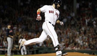 Boston Red Sox's Mitch Moreland rounds the bases after hitting a two-run home run off of Cleveland Indians relief pitcher Dan Otero, left, during the sixth inning of a baseball game Wednesday, Aug. 22, 2018, in Boston. (AP Photo/Winslow Townson)