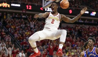 FILE - In this Feb. 13, 2018, file photo, Iowa State's Cameron Lard (2) reacts after a dunk past Kansas' Marcus Garrett (0) during the first half of an NCAA college basketball game in Ames, Iowa. Iowa State coach Steve Prohm said Thursday, Aug. 23, 2018, that Lard, who enrolled at a wellness center in early June instead of joining his teammates for summer workouts, rejoined the Cyclones earlier this month. Lard, who will be a sophomore next season, had a drug paraphernalia charge dismissed during a pretrial hearing in April. The 20-year-old Lard was also cited for being underage at an Ames bar this offseason. Those issues pushed Lard to spend time at a wellness center in an effort to make better decisions and improve as a person, according to Prohm. (AP Photo/Nati Harnik, File)