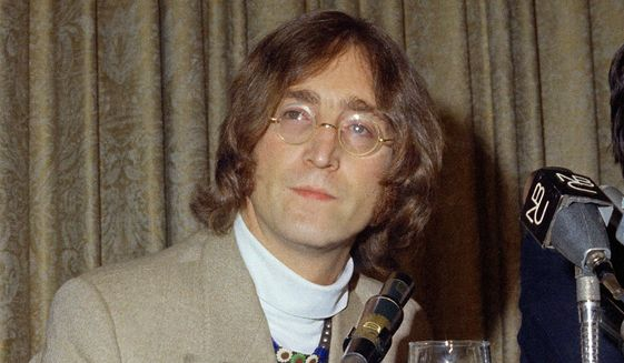 In this 1971 file photo, singer John Lennon appears during a press conference. (AP Photo, File)