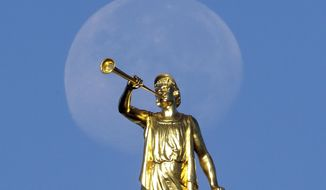 FILE - In this Sept. 11, 2014, file photo, the angel Moroni statue sits atop the Salt Lake Temple, at Temple Square, in Salt Lake City. The Mormon church is ramping up its opposition to a medical-marijuana proposal in Utah even as leaders insist they would support patients using the drugs under stricter controls. (AP Photo/Rick Bowmer, File)
