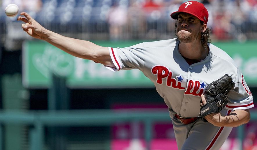 Philadelphia Phillies starting pitcher Aaron Nola throws during the first inning of a baseball game against the Washington Nationals at Nationals Park, Thursday, Aug. 23, 2018, in Washington. (AP Photo/Andrew Harnik)