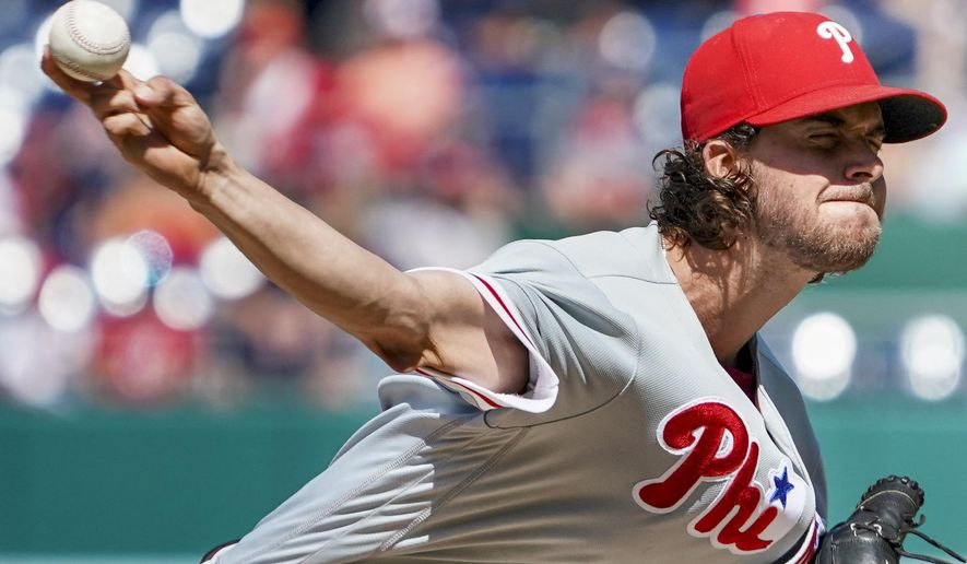 Philadelphia Phillies starting pitcher Aaron Nola (27) pitches in the eighth inning of a baseball game against the Washington Nationals at Nationals Park Thursday, Aug. 23, 2018, in Washington. The Phillies won 2-0. (AP Photo/Andrew Harnik)
