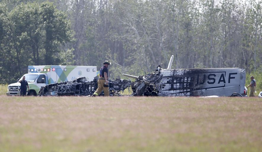 A vintage military airplane crashed and exploded Thursday, Aug. 23, 2018, at the Anoka County Airport in Blaine, Minn. Blaine Police Chief Brian Podany told reporters the pilot suffered serious injuries but is expected to recover. He was taken to a hospital. The pilot's name was not immediately released, but Podany says he's a 65-year-old from Ham Lake with more than 20 years of experience. (David Joles  /Star Tribune via AP)