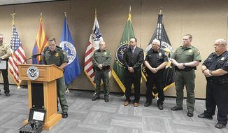 In this Wednesday, Aug. 22, 2018 photo, U.S. Border Patrol Yuma Sector Chief Patrol Agent Anthony Porvaznik, front left, talks during during a news conference at Yuma Sector U.S. Border Patrol Headquarters in Yuma, Ariz., about the recent discovery of a cross-border tunnel used to smuggle drugs in San Luis, Ariz. Federal authorities said in court documents that the tunnel was very well-built and would have taken a drug cartel a long time, and a lot of money, to dig. (Randy Hoeft/The Yuma Sun via AP)