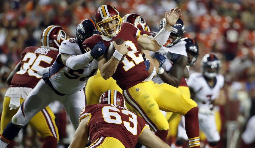 Denver Broncos linebacker Shane Ray (56) sacks Washington Redskins quarterback Colt McCoy (12) during the second half of a preseason NFL football game Friday, Aug. 24, 2018, in Landover, Md. (AP Photo/Alex Brandon) **FILE**